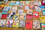 Old children's books on display at a car boot sale, UK