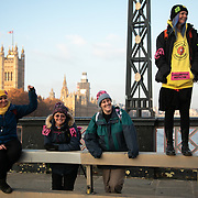 Thousands of Extinction Rebellion activists took over 5 bridges in Central London and blocked them for the day, November 17 2018, Central London, United Kingdom. Lambeth Bridge women from Lancashire and the anti-fracking movement cheer on the crowd sitting in the road on the bridge. Around 11am people on all bridges sat down in the road and blocked traffic from coming through and stayed till late afternoon. The actvists believe that the government is not doing enough to avoid catastrophic climate change and they demand the government take radical action to save future generations and the planet. Many are willing to be arrested peacefully protesting and up to 80 were arrested on the day. Extinction Rebellion is a grass root climate change group started in 2018 and has gained a huge following of people commited to peaceful protests and who ready to be arrested. Their major concern is that the world is facing catastropohic climate change and they want the British government to act now to save future generations.