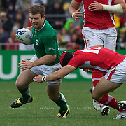 Gordon D'Arcy, Ireland, is tackled by Leigh Halfpenny during the Ireland V Wales Quarter Final match at the IRB Rugby World Cup tournament. Wellington Regional Stadium, Wellington, New Zealand, 8th October 2011. Photo Tim Clayton...