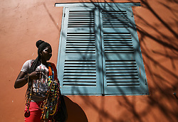 DAKAR, SENEGAL - FEBRUARY 28: A Senegalese woman sells souvenirs at the Goree Island known as 'Island of Shame' due to its bad reputation in consequence of being a center of Atlantic slave trade between 15th to 19th century, in Dakar, Senegal on February 28, 2018. Island of Shame is now used as a museum to show colonialism and slavery activities of today's 'civilized' countries such as Portugal, Netherlands, England and France.<br /> <br /> <br /> <br /> <br /> <br /> <br />  Halil Sagirkaya / Anadolu Agency  | BRAA20180308_104 Dakar Sénégal