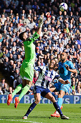 Ben Foster (ENG) of West Brom makes a save from Younes Kaboul (FRA) of Tottenham Hotspur - Photo mandatory by-line: Rogan Thomson/JMP - 07966 386802 - 12/04/2014 - SPORT - FOOTBALL - The Hawthorns Stadium - West Bromwich Albion v Tottenham Hotspur - Barclays Premier League.