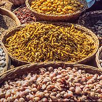 Root crops fill baskets in a bazaar in Dhaka, Bangladesh.