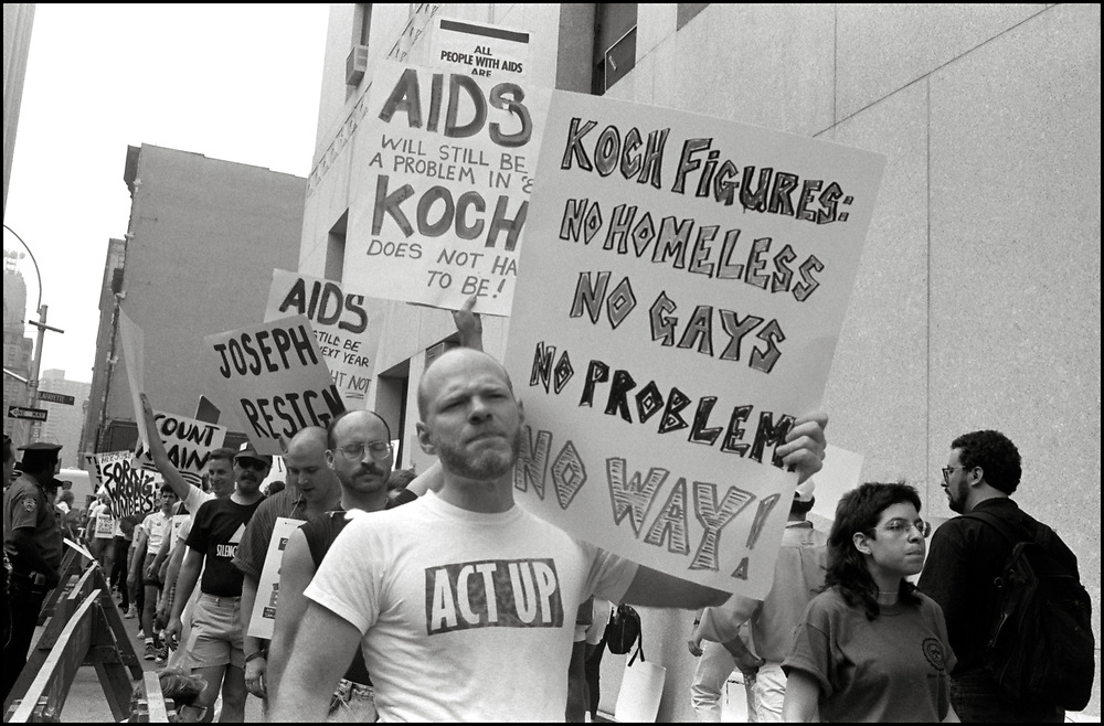 ACT UP demonstrates outside the offices of the New York City Commissioner of Health, Stephen Joseph, after he suddenly halved the number of estimated AIDS cases in NYC, on July 19th, 1988 - a move that threatened to drastically reduce funding for AIDS services