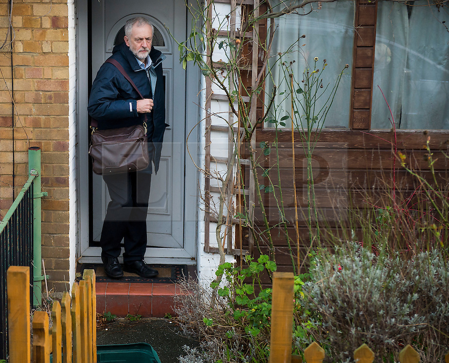 © Licensed to London News Pictures. 05/01/2016. London, UK. Labor party leader JEREMY CORBYN  leaves his home in north London on the day he is expected to announce a shadow cabinet reshuffle. Photo credit: Ben Cawthra/LNP