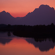 Oxbow Bend on the Snake River during an evening sunset in the fall in Grand Teton National Park, Wyoming.