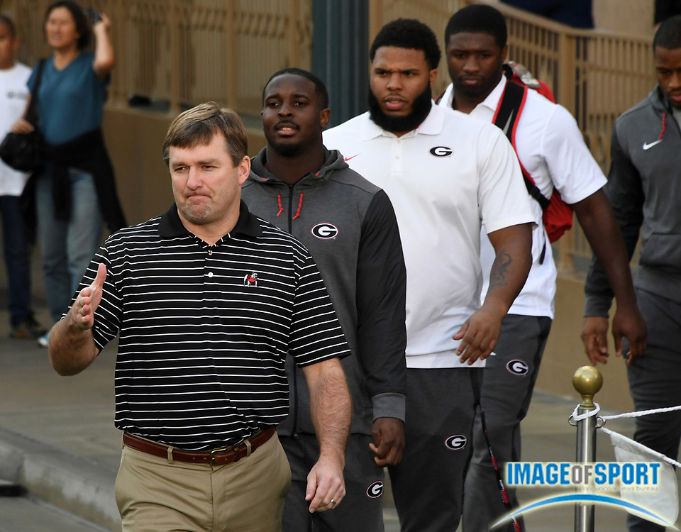 Georgia Bulldogs coach Kirby Smart (left) and tailback Sony Michel, offensive tackle Isaiah Wynn, linebacker Roquan Smith and tailback Nick Chubb arrive at Rose Bowl team visit to Disneyland in Anaheim, Calif., on Wednesday, Dec. 27, 2017.