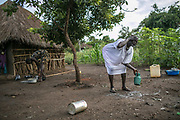 Rebecca Choul Bol, 37, right, washes her face in the morning in Bidibidi refugee settlement in Uganda. She was raped by two soldiers in December 2013 when she was three months pregnant from her husband with whom she had three children in Juba. She said four women including her were raped on their way to the UN compound in Juba. She hasn't heard anything about her husband or parents ever since.
