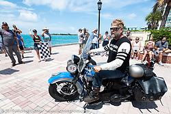 Marty Patterson riding his 1946 UL Harley-Davidson Knucklehead over the finish at the end of the Cross Country Chase motorcycle endurance run from Sault Sainte Marie, MI to Key West, FL. (for vintage bikes from 1930-1948). The Grand Finish in Key West's Mallory Square after the 110 mile Stage-10 ride from Miami to Key West, FL and after covering 2,368 miles of the Cross Country Chase. Sunday, September 15, 2019. Photography ©2019 Michael Lichter.