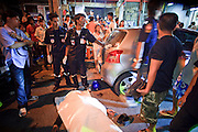 "02 OCTOBER 2009 -- BANGKOK, THAILAND: Members of the public and volunteers from the Poh Teck Tung Foundation gather around the body of a man who died in a motorcycle accident in Bangkok. The 1,000 plus volunteers of the Poh Teck Tung Foundation are really Bangkok's first responders. Famous because they pick up the dead bodies after murders, traffic accidents, suicides and other unplanned, often violent deaths, they really do much more. Their medics respond to medical emergencies, from minor bumps and scrapes to major trauma. Their technicians respond to building collapses and traffic accidents with heavy equipment and the ""Jaws of Life"" and their divers respond to accidents in the rivers and khlongs of Bangkok. The organization was founded by Chinese immigrants in Bangkok in 1909. Their efforts include a hospital, college tuition for the poor and tsunami relief.   PHOTO BY JACK KURTZ"