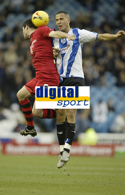 Photo: Aidan Ellis.<br /> Sheffield Wednesday v Cardiff City. Coca Cola Championship. 25/11/2006.<br /> Cardiff's Steven Thompson (L) is challenged by Wednesday's Madjid Bougherra
