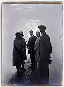 people posing inside ice glacier tunnel 1900s, at Sea of Ice Chamonix Mont Blanc