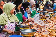 09 JULY 2013 - PATTANI, PATTANI, THAILAND:  Muslim poultry vendors in the market in Pattani.  Pattani, along with Narathiwat and Yala, are the only three Muslim majority provinces in Thailand.     PHOTO BY JACK KURTZ