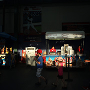 Food vendors under the stands during the New Britain Rock Cats Vs Binghamton Mets Minor League Baseball game at New Britain Stadium, New Britain, Connecticut, USA. 2nd July 2014. Photo Tim Clayton