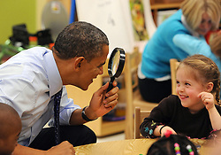 US President Barack Obama uses a spy glass to play with a young girl at College Heights Early Childhood Learning Center in Decatur, Georgia, USA on Thursday, February 14, 2013. Photo by Johnny Crawford/Atlanta Journal-Constitution/MCT/ABACAPRESS.COM  | 352666_001 Decatur Etats-Unis United States