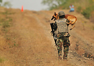 Sgt. Elizabeth Wenke hugs her dog following the Iron Dog Competitionduring the Department of Defense K9 Trials at Lackland Air Force Base in San Antonio, Texas.  They'll test military working dog teams in a variety of missions, including detecting narcotics or explosives, protecting handlers, doing building searches, and go on special search missions for miles.