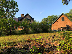 This is the luxurious mountain top home - called Tuckedaway - outside tiny Bradford, New Hampshire, where Ghislaine Maxwell was arrested on Thursday. An English man claiming to be the property manager called the police when Press arrived at the hours after her arrest. The four-bed, four-bath set on nearly 4,500 sq. ft. house, on 156 acres of land, is on East Washington Road was sold for $1.07 million in December last year to a company called Granite Reality LLC, a reference to New Hampshire's Granite State nickname. Public records reveal that Granite Reality LLC was set up on November 18 last year and registered to a waterfront office block in Boston. On Thursday federal prosecutors said that Maxwell had been hiding in New England since last July, when Epstein was arrested. She changed her phone number to one registered under 'G Max,' changed her email address, moved at least twice and when she ordered delivery packages had them delivered to a different name, which they did not specify.In a court document arguing that she should be refused bail, prosecutors said that she had at least 15 bank accounts which she owned or was associated with in the last four years. 02 Jul 2020 Pictured: This is the luxurious mountain top home - called Tuckedaway - outside tiny Bradford, New Hampshire, where Ghislaine Maxwell was arrested on Thursday. Photo credit: Richard Harbus / MEGA TheMegaAgency.com +1 888 505 6342