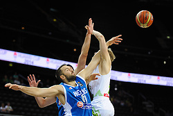 Ian-James Vougioukas of Greece vs Jaka Blazic of Slovenia during friendly match between National Teams of Slovenia and Greece before World Championship Spain 2014 on August 17, 2014 in Kaunas, Lithuania. Photo by Robertas Dackus / Sportida.com