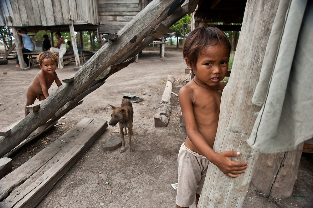 A family by their home in Cambodia.