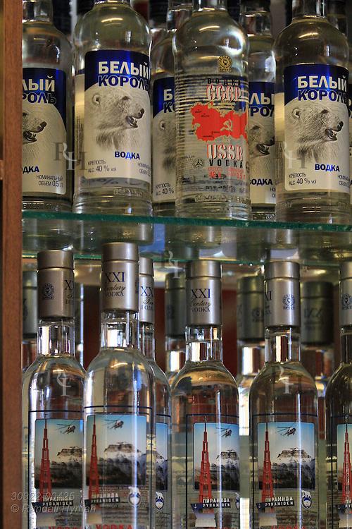Bottles of vodka fill shelf in hotel cafe at Pyramiden; Isfjorden, Spitsbergen island, Svalbard, Norway.