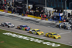 March 4, 2018 - Las Vegas, NV, U.S. - LAS VEGAS, NV - MARCH 04: Joey Logano (22) Team Penske Pennzoil Ford Fusion, Ryan Blaney (12) Team Penske Ford Fusion, Kyle Busch (18) Joe Gibbs Racing (JGR) Toyota Camry, and Kevin Harvick (4) Stewart-Haas Racing Ford Fusion drive on pit row before making a pit stop during the Monster Energy NASCAR Cup Series Pennzoil 400 on March 04, 2018 at Las Vegas Motor Speedway in Las Vegas, NV. (Photo by Chris Williams/Icon Sportswire) (Credit Image: © Chris Williams/Icon SMI via ZUMA Press)