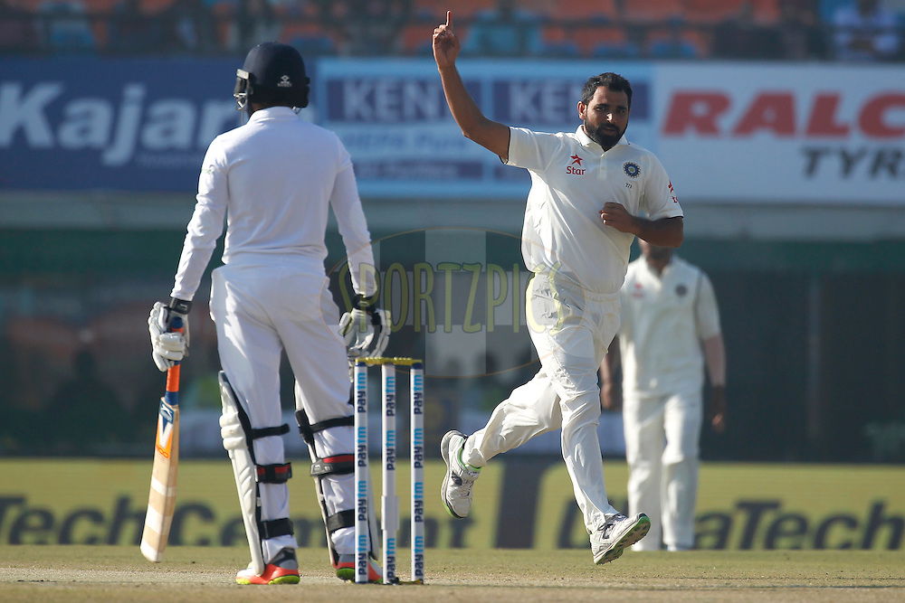 Mohammed Shami of India celebrates the wicket of Adil Rashid of England during day 2 of the third test match between India and England held at the Punjab Cricket Association IS Bindra Stadium, Mohali on the 27th November 2016.<br /> <br /> Photo by: Deepak Malik/ BCCI/ SPORTZPICS