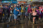 Heavy rain created a mud bath in the Glastonbury Festival 2016, United Kingdom. Glastonbury Festival is the largest greenfield festival in the world, and is now attended by around 175,000 people. Its a five-day music festival that takes place near Pilton, Somerset. In addition to contemporary music, the festival hosts dance, comedy, theatre, circus, cabaret, and other arts. Held at Worthy Farm in Pilton, leading pop and rock artists have headlined, alongside thousands of others appearing on smaller stages and performance areas.
