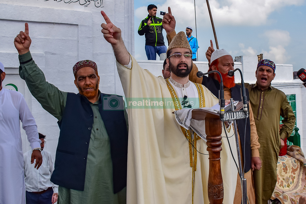 June 16, 2018 - Srinagar, Jammu and Kashmir, India - People shouts pro freedom slogans after the Eid-Ul-Fitr speech of Mirvaiz Umer Farooq In Eidgah. Kashmiri Muslims offered Eid prayers marking the festival of Eid al-Adha at  eidgah in Srinagar summer capital of Indian administered Kashmir..Eid al-Fitr marks the end of the holy month of Ramadan, during which Muslims all over the world fast from Dawn To Dusk. (Credit Image: © Abbas Idrees/SOPA Images via ZUMA Wire)