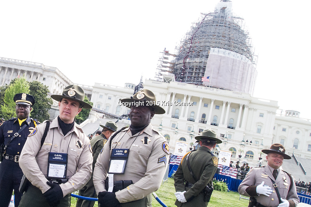"""Ventura County Deputies Steven McKnight and Larry Oriee attend the 34th Annual National Peace Officers Memorial Service to remember their fellow deputy Yehven """"Eugene"""" Kostiuchenko at the west lawn of the U.S. Capitol on May 15, 2015. Yehven, a Ukrainian hit by a drunk driver last October who came to the U.S. to investigate a money laundering case and met his future wife. Photo by Kris Connor"""