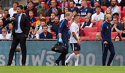 Tottenham Hotspur's Kieran Trippier (second right) leaves the field of play during the pre-season friendly match at Wembley Stadium, London.