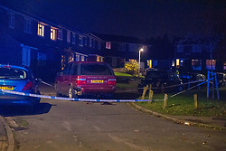 © Licensed to London News Pictures. 02/11/2020. Maidenhead, UK. A damaged vehicle, believed to be connected with the incident, sits inside a police cordon on  Switchback Close, approximately 1 mile away. A house has been 'petrol-bombed' on Moor Lane in Maidenhead, an altercation took place on the roadside before what is believed to be a petrol-bomb was throw at the house causing exterior damage. Photo credit: Peter Manning/LNP