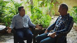 Bartolo Fuentes and Sean Hawkey talk about migration in San Pedro Sula.