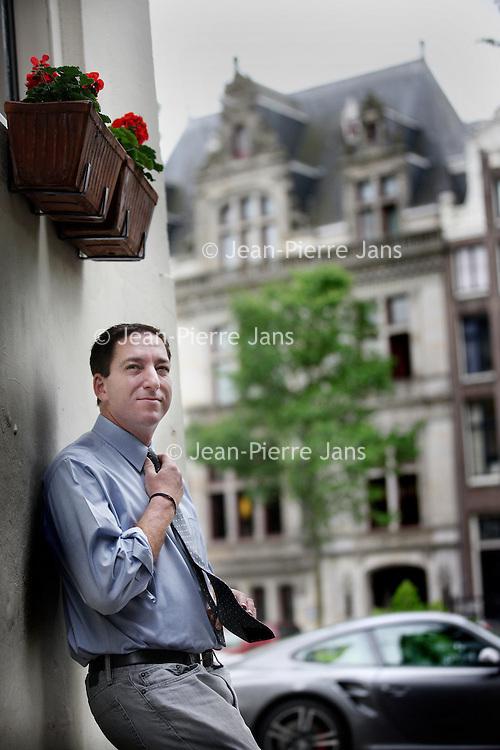 Nederland, Amsterdam , 20 mei 2014.<br /> Glenn Greenwald, ex-The Guardian, onthulde hoe de NSA wereldwijd inlichtingen tapt. De Amerikaan had één bron: Edward Snowden. Vorige week verscheen Greenwalds boek.<br /> Glenn Greenwald, ex-The Guardian revealed how the NSA intercepted information worldwide. The American had only one source: Edward Snowden. Last week Greenwald's book was published.
