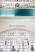 Entrance of the re-opened Carnegie Library on Herne Hill in south London which has opened its doors for the first time in almost 2 years, on 15th February 2018, in London, England. Closed by Lambeth council and occupied by protesters for 10 days in 2016, the library bequeathed by US philanthropist Andrew Carnegie has been locked ever since because, say Lambeth austerity cuts are necessary. A gym that locals say they dont want or need has been installed in the listed basement and actual library space a fraction as before and its believed no qualified librarians will be present to administer it. Protesters also believe this community building will ultimately sold off by Lambeth council for luxury homes.