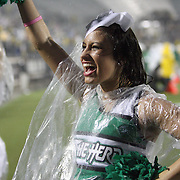 Marshall cheerleaders cheer in the downpour during an NCAA football game between the Marshall Thundering Herd and the Central Florida Knights at Bright House Networks Stadium on Saturday, October 8, 2011 in Orlando, Florida. (Photo/Alex Menendez)