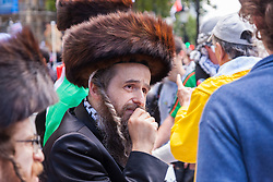 London, August 23rd 2014. Jews from the Naturei Karta sect who are opposed to Zionism join protesters outside Downing Street demanding that Britain stops arming Israel.