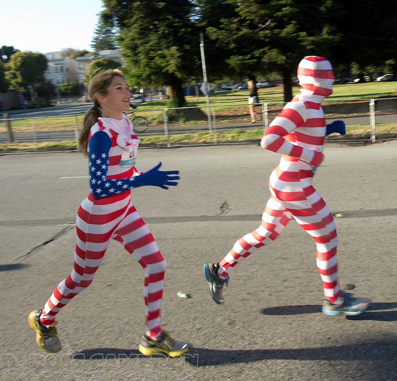 Participants clad in the colors of the American flag make their way west on Fell Street during the 102nd Bay to Breakers 12K in San Francisco, Sunday, May 19, 2013. More than 30,000 runners -- from the elite to the weekend warrior -- made the 7.62-mile trek from Howard and Spear to the Great Highway. (Photo by D. Ross Cameron)