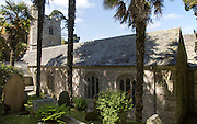 Historic church amidst sub-tropical plants, St Just in Roseland, Cornwall, England, UK