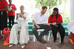 Rihanna (second left) and Prince Harry take part in a live HIV test, at the 'Man Aware' event held by the Barbados National HIV/AIDS Commission in Bridgetown, Barbados, during his tour of the Caribbean.