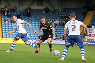 Newport County's Andrew Hughes brings the ball forward watched closely by Bury's defender Shaun Beeley. Skybet Football League two match, Bury v Newport county at Gigg Lane in Bury on Saturday 5th Oct 2013. pic by David Richards, Andrew Orchard sports photography,