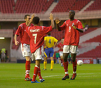 Fotball<br /> U21 England v Ukraina<br /> 17.08.2004<br /> Foto: SBI/Digitalsport<br /> NORWAY ONLY<br /> <br /> England's Carlton Cole (R) celebrates scoring his side's first goal with Jermaine Pennant (C)