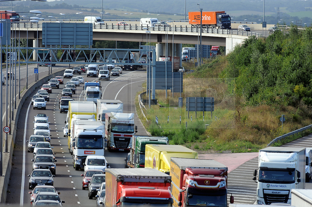 © Licensed to London News Pictures. 28/08/2015<br /> August Bank holiday getaway traffic M25.<br /> After the morning work commute the M25 at Junction 2 towards Dartford in Kent,  Anti-clock wise at 9.30am is at a near stand still with the volume of traffic.<br /> <br /> (Byline:Grant Falvey/LNP)
