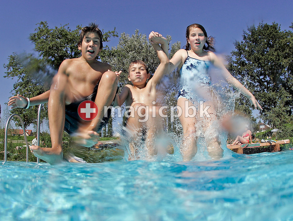 Three teenagers jump in the public outdoor swimming pool on Wednesday August 31, 2005 in Zurich-Seebach, Switzerland. (Photo by Patrick B. Kraemer / MAGICPBK)
