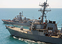 April 6, 2017 - *FILE PHOTO* - President Trump ordered a massive military strike on a Syrian air base in retaliation for a 'barbaric' chemical attack he blamed on Syria's President. Navy gun ships USS Porter and USS Ross targeted Shayrat Airfield in Syria, where planes that carried out the chemical attack where launched from. Pictured: June 2, 2015 - Black Sea, Ukraine - The U.S Navy guided-missile destroyer USS ROSS steams alongside the Ukranian Navy Frigate Hetman Sahaydachniy during training operations with the June 2, 2015 in the Black Sea. (Credit Image: © Mcs3 Robert S. Price/U.S. Navy/ZUMA Wire/ZUMAPRESS.com)