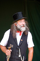 folk musician playing a traditiona instrument at a steam fair