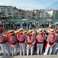 "VENICE, ITALY - SEPTEMBER 02:  Members of the ""Coro della Serenissima"" sing before the blessing of the Gondolini in front of Santa Maria della Salute church ahead of Sunday Historic Regata on September 2, 2010 in Venice, Italy. The Historic Regata is the most exciting boat race on the Gran Canal for the locals and one of the most spectacular ***Agreed Fee's Apply To All Image Use***.Marco Secchi /Xianpix. tel +44 (0) 207 1939846. e-mail ms@msecchi.com .www.marcosecchi.com"