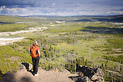 A visitor enjoys Observation Point along the Mystic Falls Trail, Yellowstone National  Park, Wyoming.