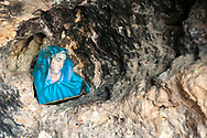 A cheap icon of the Virgin Mary placed in a historic cave in Qana, Lebanon. This town is where some people believe Jesus performed his first miracle of changing water to wine.