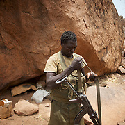 May 02, 2012 - Kauda, Nuba Mountains, South Kordofan, Sudan: A Sudan People's Liberation Movement (SPLA-N) rebel fighter prepares his weapons for an attack on Sudan's Armed Forces (SAF) positions near Tess village in the rebel-held territory of the Nuba Mountains in South Kordofan. SPLA-North, a historical ally of SPLA, South Sudan's former rebel forces, has since last June being fighting the Sudanese Army Forces (SAF) over the right to autonomy and of the end of persecution of Nuba people by the regime of President Bashir.