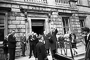 Sean Lemass TD waves to supporters as he leaves Leinster House following his re-election as Taoiseach. .11.04.1965