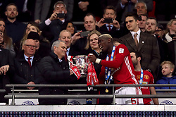 File photo dated 26-02-2017 of Manchester United manager Jose Mourinho and Paul Pogba with the trophy after the EFL Cup Final at Wembley Stadium, London.